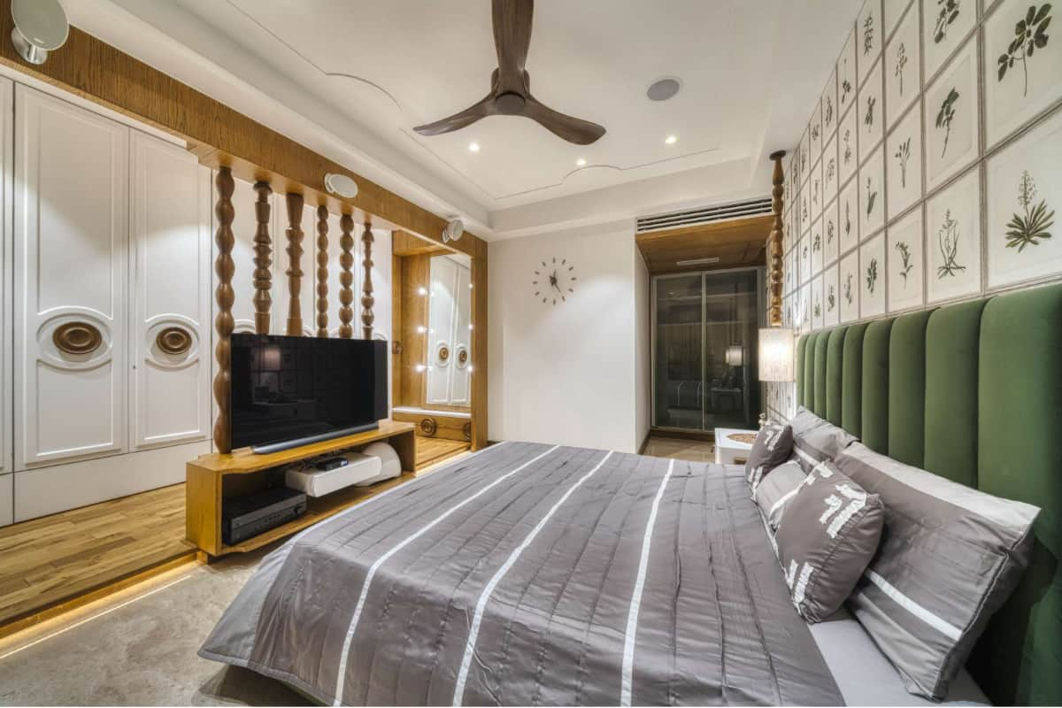 Olive green is predominant in this room to showcase and put the totems in the limelight, whether in the bed headboard, the leaf wallpaper or the ombré effect in the sliding glass shutters <br> photographs: Pooja Bihani, Spaces and Design