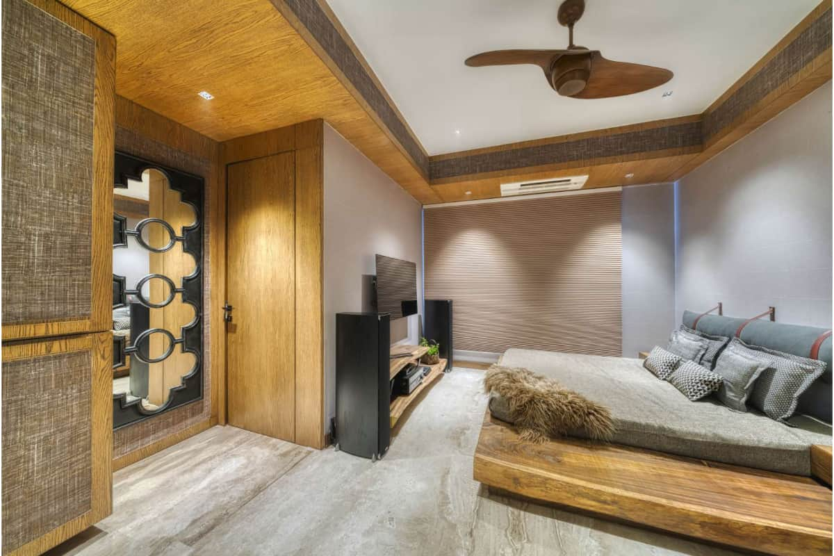 The den and family room is made of raw logs of wood placed as tv ledges and bed platform <br> photographs: Pooja Bihani, Spaces and Design